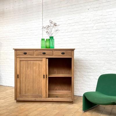Oak cabinet with sliding doors
