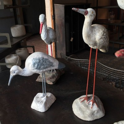 Series of storks in cement