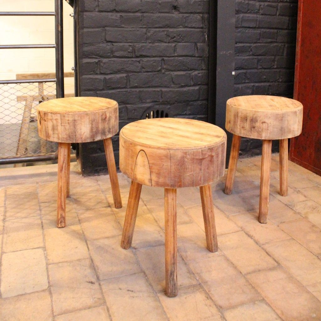Set of tripod wooden stools