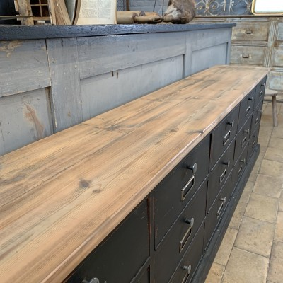 Wooden cabinet with flaps