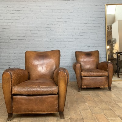 Paire de fauteuils club en cuir 1930