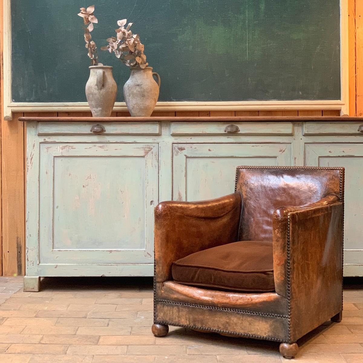 Ancien fauteuil club en cuir