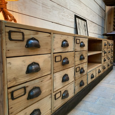 Low wooden cabinet with drawers