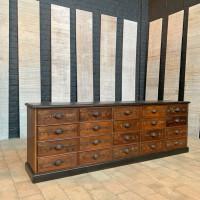 Former base cabinet in oak hardware