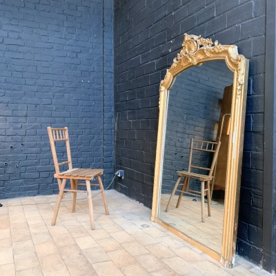 Large antique mirror in wood and gilded stucco