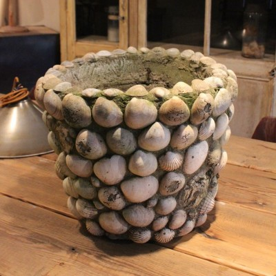 Old garden pot shells in concrete